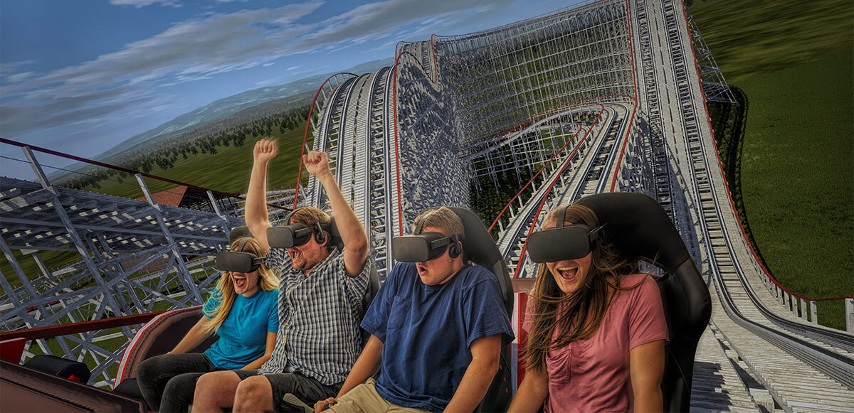 Row of laughing and smiling friends, some with their hands up, experiencing VR InMotion coaster.